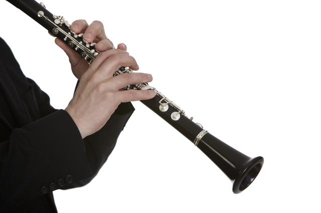Clarinet player in front of white background